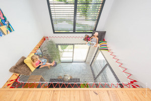 A playroom with suspended net and red rope